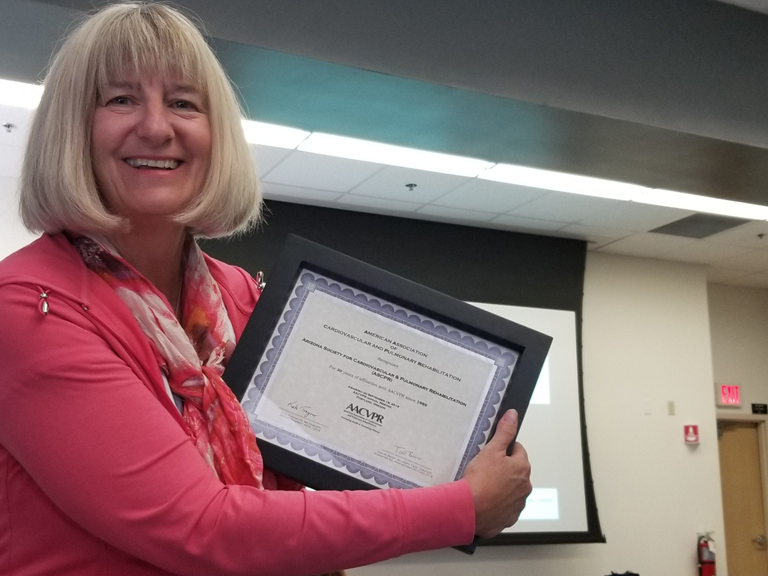 Holly accepting the Certificate of Recognition for our ASCVPR Chapter from AACVPR
